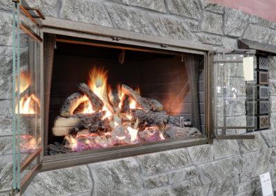 Fireplace Wall-Gas Logs Burning