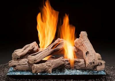 contemporary pan blue glass with firelogs